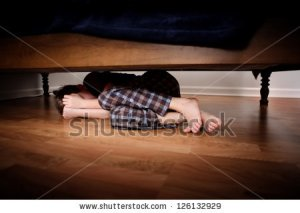 stock-photo-fearful-boy-hiding-under-the-bed-126132929