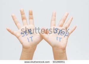 stock-photo-see-it-stop-it-written-on-the-child-s-hand-50186851